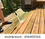 cleaning wooden deck with... | Shutterstock . vector #656405263