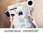 reading newspaper on desk | Shutterstock . vector #656483287
