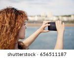 woman taking a picture with a... | Shutterstock . vector #656511187