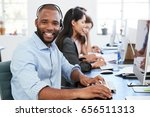 young black man with headset on ... | Shutterstock . vector #656511313