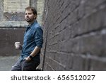 handsome man drinking a cup of... | Shutterstock . vector #656512027