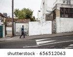 man climbing an uphill in an... | Shutterstock . vector #656512063