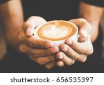 hands holding hot cup of coffee ... | Shutterstock . vector #656535397