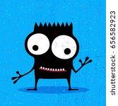 cute black monster with... | Shutterstock .eps vector #656582923
