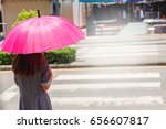Woman With Pink Umbrella Going...
