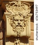 Small photo of Plaster face on the façade, Saint-Petersburg