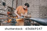 blacksmith forging an knife... | Shutterstock . vector #656869147