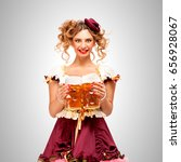 beautiful oktoberfest waitress... | Shutterstock . vector #656928067