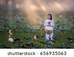 beautiful woman wearing ao dai... | Shutterstock . vector #656935063
