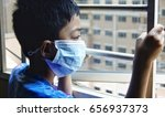 young boy wearing face mask... | Shutterstock . vector #656937373