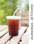 Small photo of Ice of americano with coffee cafe shop blur background