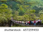 Small photo of Ono District, Gifu Prefecture, Japan-May 11, 2017: Visitors are crossing bridge to visit Shirakawa go village.