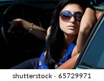 beautiful woman in a car | Shutterstock . vector #65729971