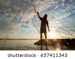 a fisherman cast a net at lake... | Shutterstock . vector #657411343