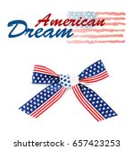 Small photo of Text AMERICAN DREAM and festive bow on white background