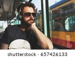 young man riding in public...   Shutterstock . vector #657426133