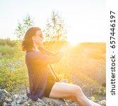 girl at sunset  holding sun in... | Shutterstock . vector #657446197