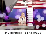 a television anchorwoman at... | Shutterstock . vector #657549133