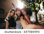 three beautiful young girls... | Shutterstock . vector #657584593