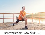 young fit man stretching legs... | Shutterstock . vector #657588133