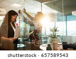 creative people working on new... | Shutterstock . vector #657589543