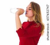 young pretty girl drinks fresh... | Shutterstock . vector #657652747