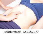 young woman's abdomen being... | Shutterstock . vector #657657277