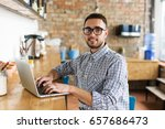 happy man working on laptop.... | Shutterstock . vector #657686473
