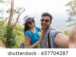 couple with backpacks take... | Shutterstock . vector #657704287