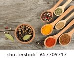 spices in spoon on old wood... | Shutterstock . vector #657709717