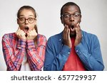 two astonished fascinated young ... | Shutterstock . vector #657729937