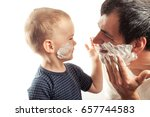 father and son shaves.  family... | Shutterstock . vector #657744583