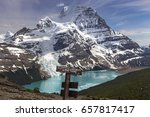 Distant Snowy Mountain Robson Peak and Berg Lake Landscape from Toboggan Falls Hiking Table Sign near Jasper National Park, Rocky Mountains British Columbia Canada