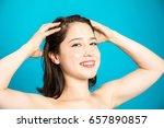 beautiful woman massaging her... | Shutterstock . vector #657890857