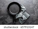 empty cast iron frying pan on... | Shutterstock . vector #657913147