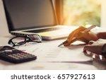 businessman holding paperwork...   Shutterstock . vector #657927613