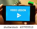 hands holding phone with video... | Shutterstock . vector #657955513
