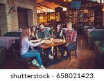 friends having a drinks in a... | Shutterstock . vector #658021423