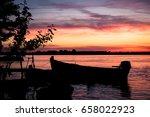 pink sunset. silhouette of a... | Shutterstock . vector #658022923