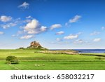 lindisfarne castle on holy... | Shutterstock . vector #658032217