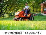gardener driving a riding lawn... | Shutterstock . vector #658051453