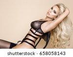 elegant female model in black...   Shutterstock . vector #658058143