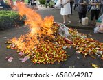 burning silver and gold paper ... | Shutterstock . vector #658064287