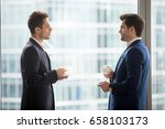 side view of two serious young... | Shutterstock . vector #658103173
