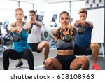 women and men exercising with... | Shutterstock . vector #658108963