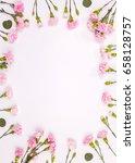 frame made of pink carnation... | Shutterstock . vector #658128757