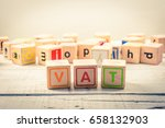 word ' vat ' wood cubic on the... | Shutterstock . vector #658132903