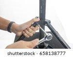 hand wiht ratchet spanner | Shutterstock . vector #658138777