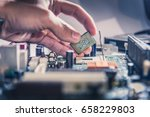 the technician is putting the... | Shutterstock . vector #658229803