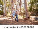 mature couple hiking along... | Shutterstock . vector #658238287